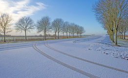 Snowy road through the countryside Royalty Free Stock Photos