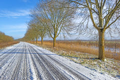Snowy road through the countryside Stock Photo
