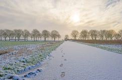 Snowy road through the countryside Stock Photos