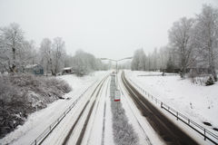 Snowy road at gloomy winter day Royalty Free Stock Photo