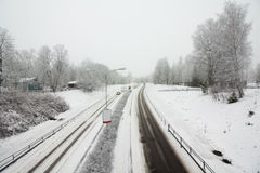 Snowy road at gloomy winter day Royalty Free Stock Images