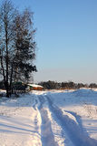Snowy road home. Snow-covered road to the little house in the suburbs Royalty Free Stock Images