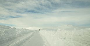 Snowy road in Iceland. This sight is pretty standard in winter and spring, just love how everything is white royalty free stock image