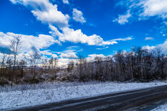 Snowy road in the italian countryside Stock Photo