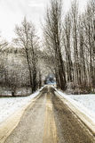 Snowy road in the italian countryside Royalty Free Stock Images
