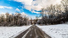 Snowy road in the italian countryside Stock Photos