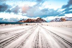 Snowy road leading to the Skagsanden mountain. In the background stock photography