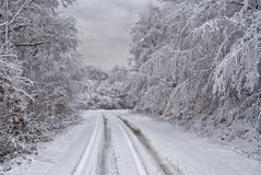 Snowy road in mountain 3 Royalty Free Stock Images