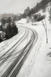 Snowy road in the mountains Stock Photography