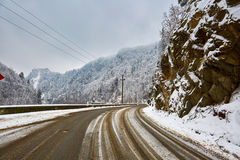 Snowy road in the mountains Stock Photo