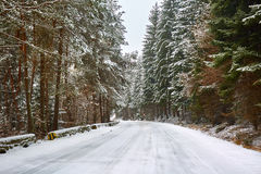 Snowy road in the mountains Stock Photos