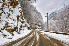 Snowy road in the mountains Stock Images