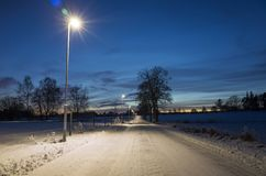 Snowy road at night in Katrineholm Sweden Scandinavia. Snowy road in Katrineholm Sweden Scandinavia. Beautiful dusk evening after sunset. Cold winter night with Stock Image