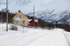 Snowy road in norwegian countryside Stock Photos