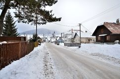Snowy road. Route running along the idyllic countryside in Slovakia royalty free stock images