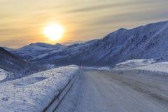 Snowy road on Senja Island Stock Images