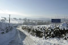 Snowy Road with sign Stock Photography