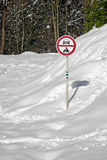 Snowy road with sign no entry Stock Photography