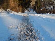 Snowy road. Snow on the road shows how much they clean it Stock Photography