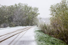 Snowy road during sudden April snow storm in Ukraine Royalty Free Stock Photos