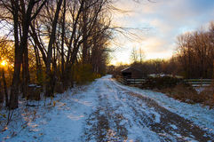 Snowy road at sunset Royalty Free Stock Image