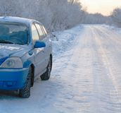 Snowy road surfacee car Royalty Free Stock Photography