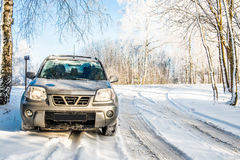 Snowy road and suv car Royalty Free Stock Photo