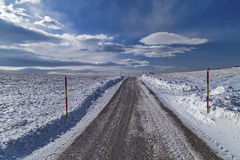 Snowy Road To The Skys. Snowy Road with beautiful sky Royalty Free Stock Photos