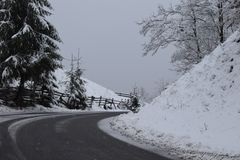 Snowy road on top of the mountains royalty free stock photos