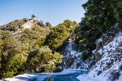 Snowy road on top of Mt Hamilton, San Jose. South San Francisco bay area, California royalty free stock photo