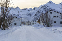 Snowy road through the township of Mefjordvaer Stock Images