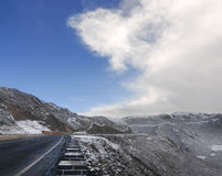 Snowy road under freezing blue sky Royalty Free Stock Images