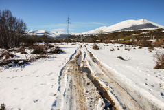 Snowy road. Through the valley Stock Image