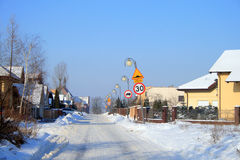 Snowy road in a village Stock Image