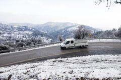 Snowy Road. White truck on the snowy road Stock Photos