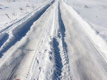 Snowy road in winter Royalty Free Stock Photos