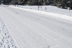 Snowy road in winter Stock Photos