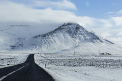 Snowy road in wintertime Royalty Free Stock Photos