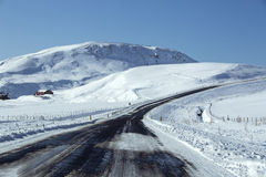 Snowy road in wintertime Stock Photography