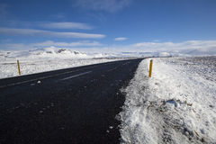 Snowy road in wintertime. Iceland Stock Photos