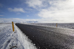 Snowy road in wintertime Royalty Free Stock Photo