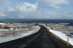 Snowy road in wintertime. Iceland Royalty Free Stock Images