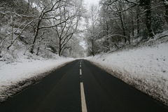 Snowy Road. Wintery snowy road, leading into the distance Royalty Free Stock Image