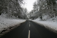 Snowy Road. Wintery snowy road, leading into the distance Royalty Free Stock Photos
