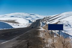 Snowy roads and road sign Royalty Free Stock Photo