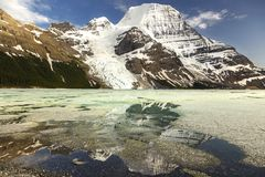 Berg Lake and Mount Robson. Snowy Robson Mountain Top and Berg Lake Landscape from great hiking trail near Jasper National Park in Rocky Mountains British Stock Photography