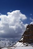 Snowy rocks in clouds Royalty Free Stock Image