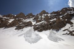 Snowy rocks and trace from avalanche Stock Photo