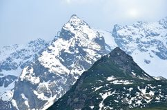 Snowy rocky mountain peaks. Royalty Free Stock Photography