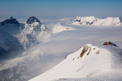 Snowy and Rocky Mountains in France. A picture of a mountain landscape in the winter in Devoluy, France. The valleys were covered by clouds, but higher up the Royalty Free Stock Image